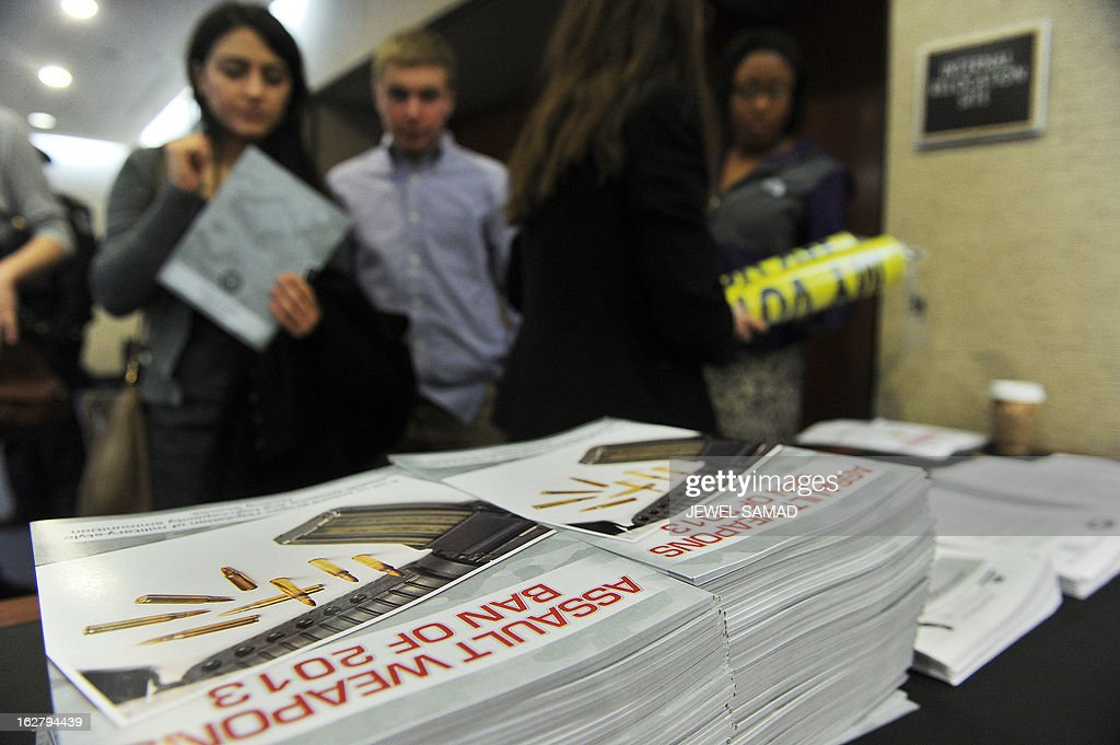 Attendees collect booklets as they attend Senate Judiciary Committee hearing on 'The Assault Weapons Ban of 2013' at the Hart Senate Office Building in Washington, DC, on February 27, 2013. AFP PHOTO/Jewel Samad