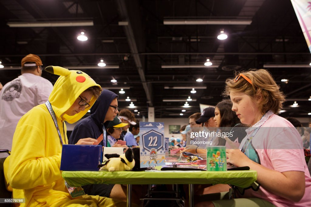 Attendees compete during the 2017 Pokmon Co. World Championships in Anaheim, California, U.S., on Friday, Aug. 18, 2017. The invitation-only event brings the best players from around the world to compete for the title of Pokémon TCG, Video Game, or Pokkén Tournament World Champion. Photographer: Troy Harvey/Bloomberg via Getty Images