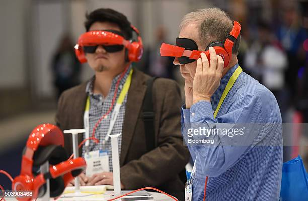 Attendees demonstrate the RoyoleX foldable smart mobile theater device during the 2016 Consumer Electronics Show in Las Vegas Nevada US on Thursday...