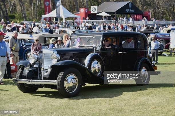 Attendees drive in a 1930 Marmon Sixteen luxury vehicle during the 2017 Amelia Island Concours d'Elegance in Amelia Island Florida US on Saturday...