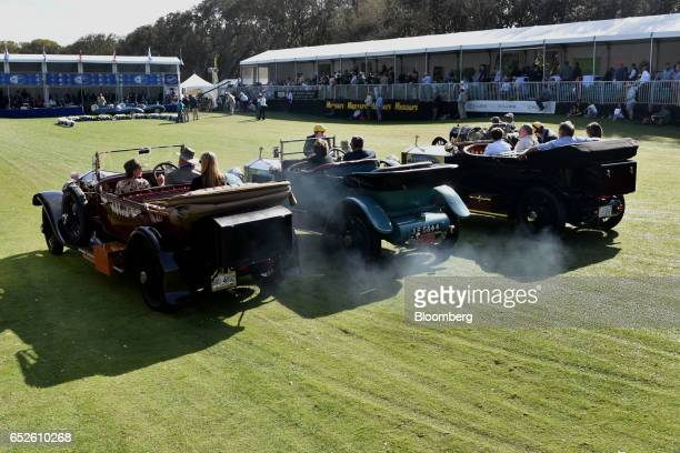Attendees drive three RollsRoyce Silver Ghost convertible luxury vehicles during the 2017 Amelia Island Concours d'Elegance in Amelia Island Florida...