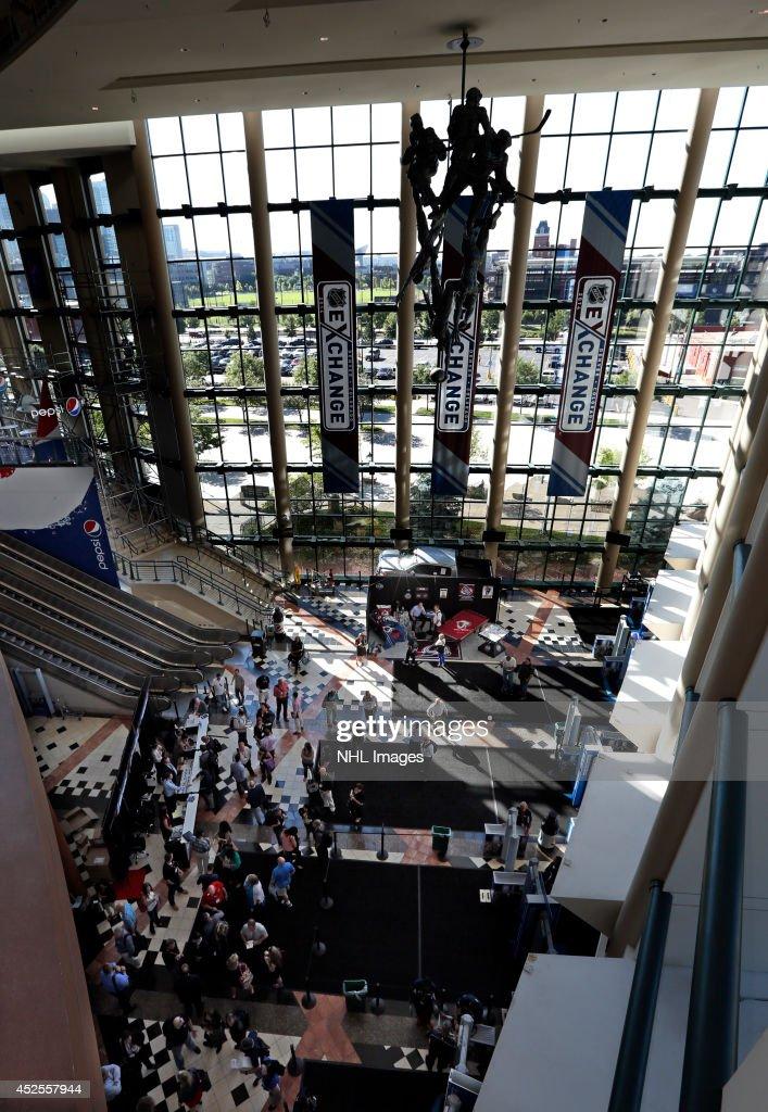 Attendees enter the 2014 NHL Exchange at Pepsi Center on July 22, 2014, in Denver, Colorado.