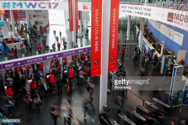 Attendees enter the conference center on the third day of Mobile World Congress in Barcelona Spain on Wednesday March 1 2017 A theme this year at the...