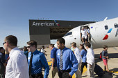 Attendees exit an American Airlines Inc aircraft at DallasFort Worth International Airport during a recruiting event in Dallas Texas US on Wednesday...