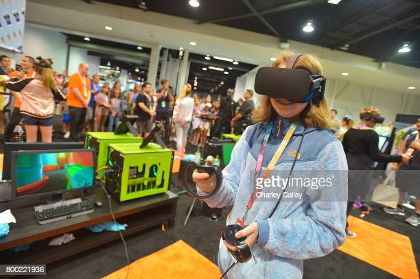 Attendees experience NickelodeonÕs SlimeZone Virtual Reality experience at VidCon 2017 at the Anaheim Convention Center on June 23 2017 in Anaheim...