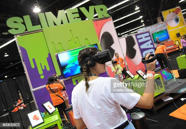 Attendees experience Nickelodeon's SlimeZone Virtual Reality experience at VidCon 2017 at the Nickelodeon Booth at VidCon 2017 at Anaheim Convention...