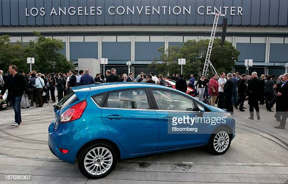 Attendees gather around after the new Ford Motor Co Fiesta ST hatchback vehicle is introduced during the LA Auto Show in Los Angeles California US on...