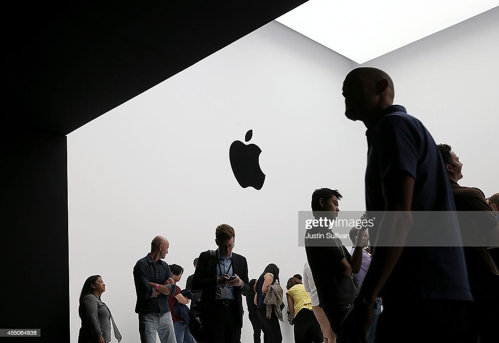 Attendees gather during an Apple special event at the Flint Center for the Performing Arts on September 9 2014 in Cupertino California Apple...