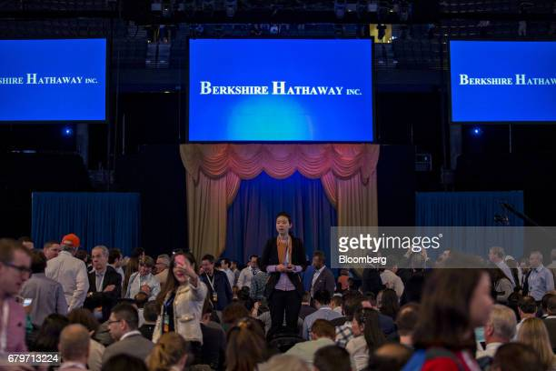 Attendees gather in the CenturyLink Center arena before the start of the Berkshire Hathaway Inc annual meeting in Omaha Nebraska US on Saturday May 6...