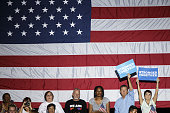 Attendees hold campaign signs before the start of an event with Hillary Clinton presumptive 2016 Democratic presidential nominee not pictured in...