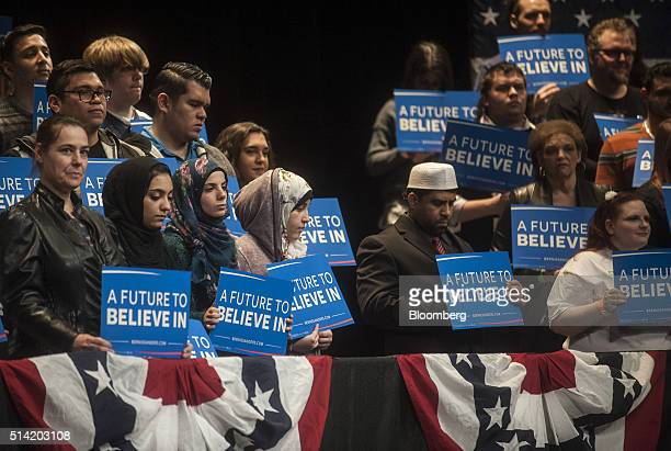 Attendees hold signs during a campaign event for Senator Bernie Sanders an independent from Vermont and 2016 Democratic presidential candidate not...