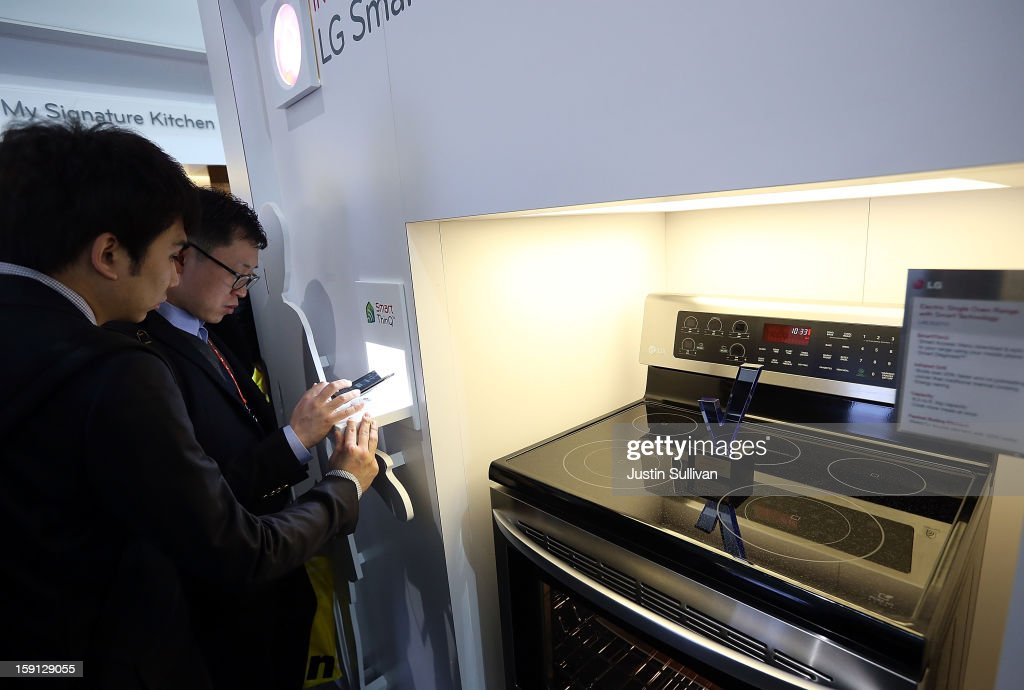 Attendees inspect an LG Smart Oven during the 2013 International CES at the Las Vegas Convention Center on January 8, 2013 in Las Vegas, Nevada. CES, the world's largest annual consumer technology trade show, runs from January 8-11 and is expected to feature 3,100 exhibitors showing off their latest products and services to about 150,000 attendees.