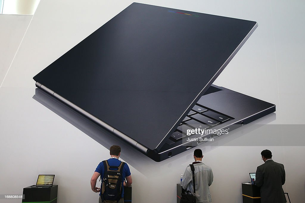 Attendees inspect the Google Chromebook Pixel laptop during the Google I/O developers conference at the Moscone Center on May 15, 2013 in San Francisco, California. Thousands are expected to attend the 2013 Google I/O developers conference that runs through May 17. At the close of the markets today Google shares were at all-time record high at $916 a share, up 3.3 percent.