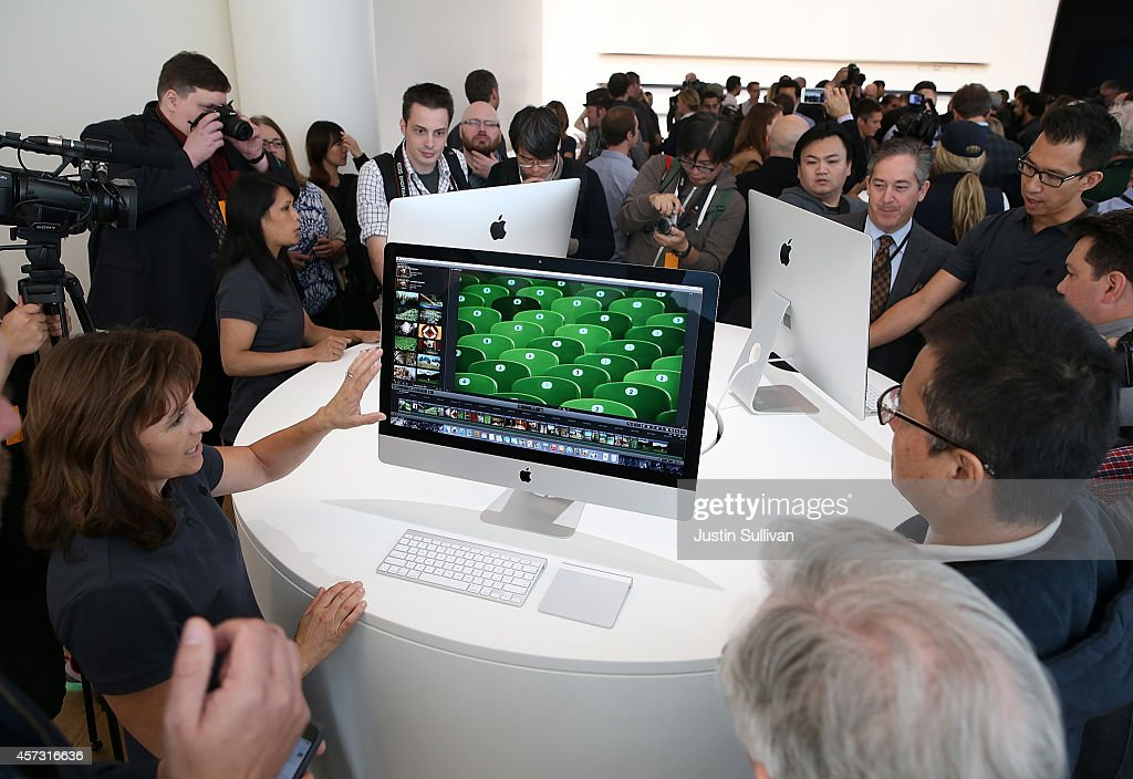 Attendees inspect the new 27 inch iMac with 5K Retina display during an Apple special event on October 16 2014 in Cupertino California Apple unveiled...