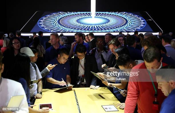 Attendees inspect the new iPad Pro during the 2017 Apple Worldwide Developer Conference at the San Jose Convention Center on June 5 2017 in San Jose...