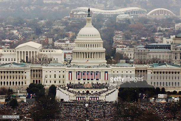 Attendees line the Mall as they watch ceremonies to swear in Donald Trump on Inauguration Day on January 20 2017 in Washington DC Donald J Trump will...