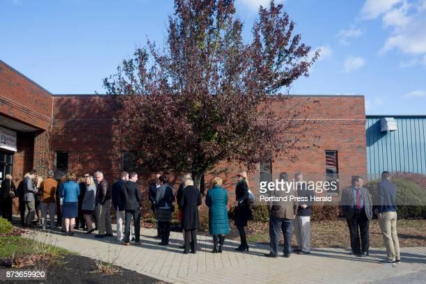 Attendees line up before the doors open at Volk Packaging Corporation to see Ivanka Trump US Treasurer Jovita Carranza and Sen Susan Collins speak at...