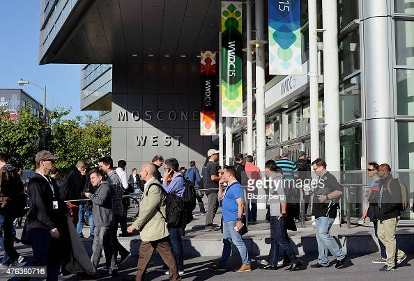 Attendees line up to enter the Moscone Center before the start of the Apple World Wide Developers Conference in San Francisco California US on Monday...