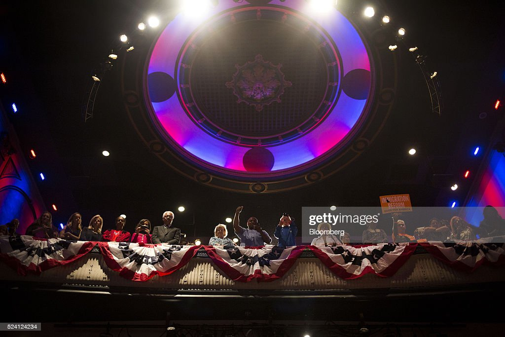 Attendees listen as Hillary Clinton former Secretary of State and 2016 Democratic presidential candidate not pictured speaks during a campaign event...