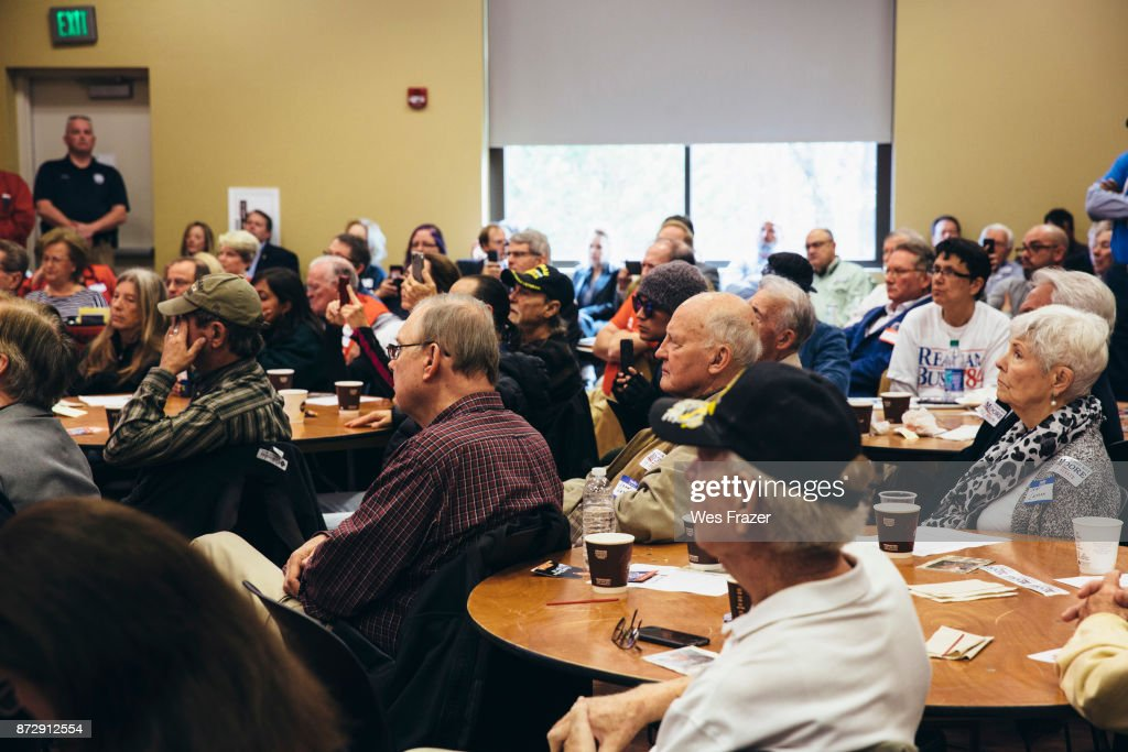 Attendees listen as Republican candidate for U.S. Senate Judge Roy Moore appears at a mid-Alabama Republican Club's Veterans Day event on November 11, 2017 in Vestavia Hills, Alabama. This week Moore's campaign was brought under scrutiny, after being accused of sexual misconduct with underage girls when he was in his 30's.