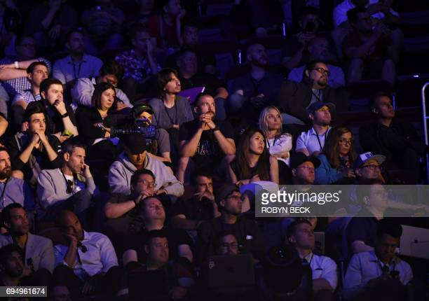 Attendees listen as the Xbox One X is introduced at the Microsoft Xbox E3 2017 Briefing June 11 2017 at the Galen Center in Los Angeles California...
