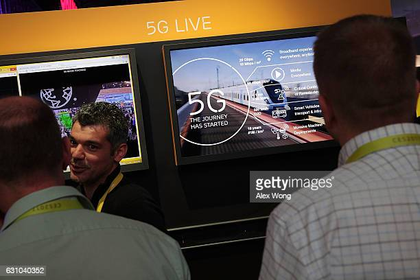Attendees listen to information about 5G aka 5th generation mobile networks at the Ericsson booth during CES 2017 at the Las Vegas Convention Center...