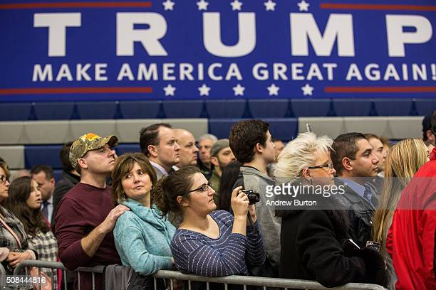 Attendees listen to Republican presidential hopeful Donald Trump speak at a rally at Great Bay Community College on February 4 2016 in Portsmouth New...
