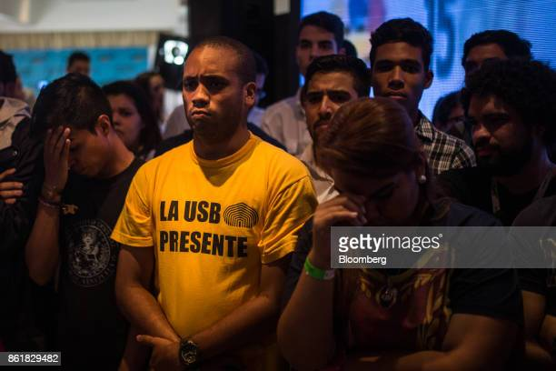 Attendees listen to results at the oppositions's campaign headquarters during state governors elections in Caracas Venezuela on Sunday Oct 15 2017...