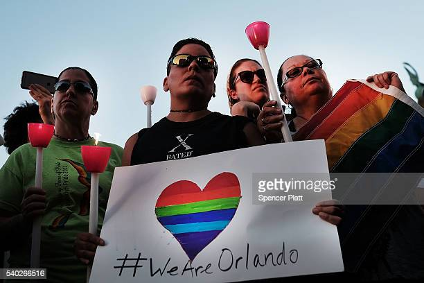 Attendees listen to speakers at a memorial gathering for those killed in Orlando at Grand Army Plaza on June 14 2016 in the Brooklyn borough of New...