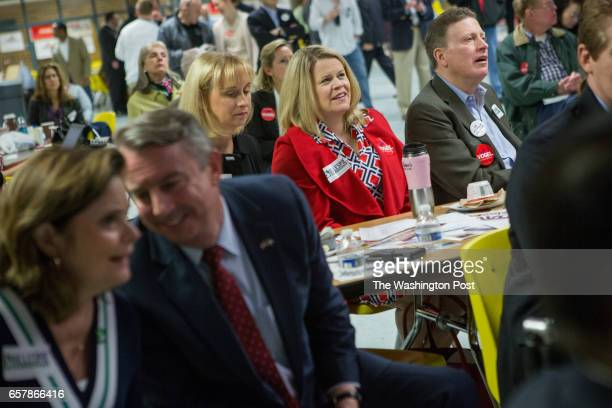 Attendees listen to speakers at the Fairfax County Republican Committee Straw Poll Candidate Forum at Robinson Secondary School in Fairfax VA March...