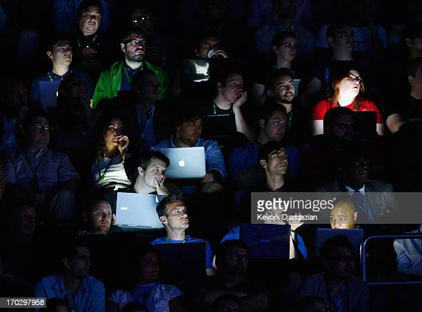 Attendees listen to speakers during the Microsoft Xbox news conference at the Electronic Entertainment Expo at the Galen Center on June 10 2013 in...