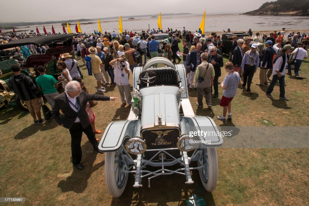 Attendees look at a 1914 American Underslung 642 Roadster during the 2013 Pebble Beach Concours d' Elegance in Pebble Beach, California, U.S., on Sunday, Aug. 18, 2013. The annual event in its 63rd year raised $1.277 million U.S. dollars for charity and showcased 248 cars, 48 from abroad. Photographer: David Paul Morris/Bloomberg via Getty Images