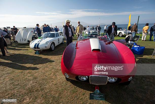 Attendees look at a 1954 ArnoltBristol Bertone Bolide Deluxe during the 2015 Pebble Beach Concours d'Elegance in Pebble Beach California US on Sunday...
