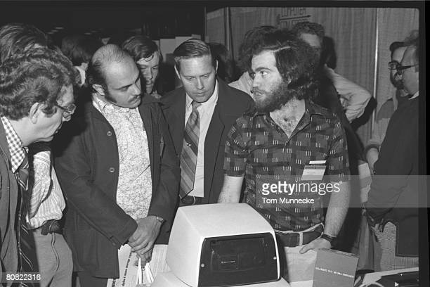 Attendees look at a computer at the first West Coast Computer Faire in Brooks Hall San Francisco California April 16th or 17th 1977