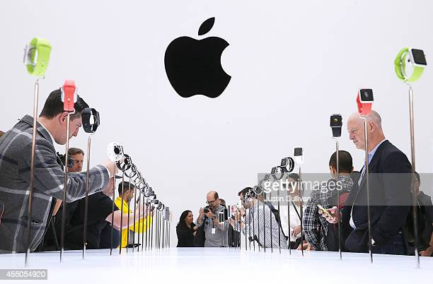 Attendees look at a display of the new Apple Watch during an Apple special event at the Flint Center for the Performing Arts on September 9 2014 in...