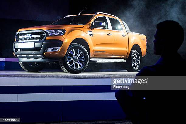 Attendees look at a new Ford Ranger 'Wildtrack' pickup truck during a presentation at the Ford Motor Co 'Go Further' event at the Sandton Convention...