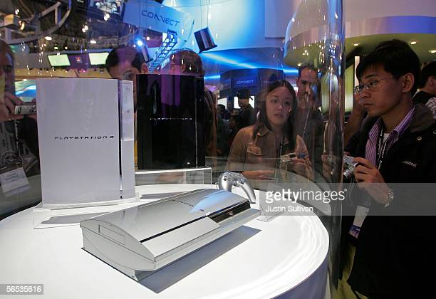 Attendees look at a prototype of the Sony Playstation 3 on the second day of the 2006 Consumer Electronics Show January 6 2006 in Las Vegas Nevada...