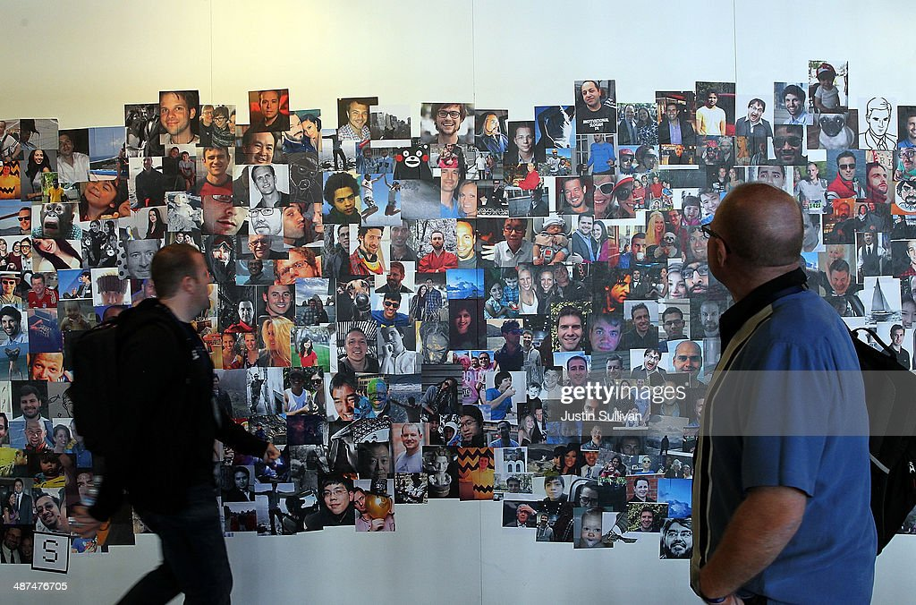 Attendees look at a wall of photos at the Facebook f8 conference on April 30, 2014 in San Francisco, California. Facebook CEO Mark Zuckerberg kicked off the annual one-day F8 developers conference.