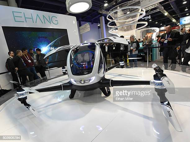 Attendees look at an EHang 184 autonomousflight drone that can fly a person at CES 2016 at the Las Vegas Convention Center on January 7 2016 in Las...