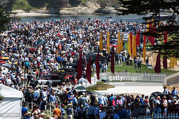 Attendees look at cars displayed during the 2015 Pebble Beach Concours d'Elegance in Pebble Beach California US on Sunday Aug 16 2015 At last year's...