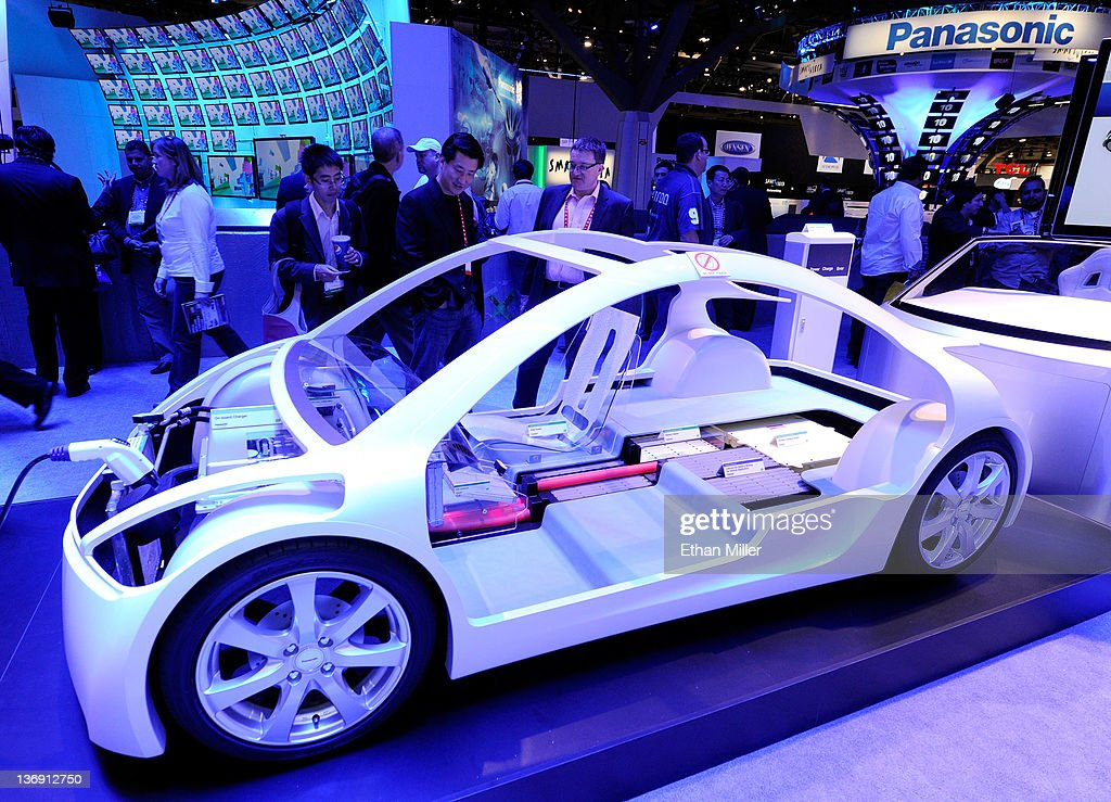 Attendees look at components for an electric vehicle at the Panasonic booth at the 2012 International Consumer Electronics Show at the Las Vegas Convention Center January 12, 2012 in Las Vegas, Nevada. CES, the world's largest annual consumer technology trade show, runs through January 13 and features more than 3,100 exhibitors showing off their latest products and services to about 140,000 attendees.