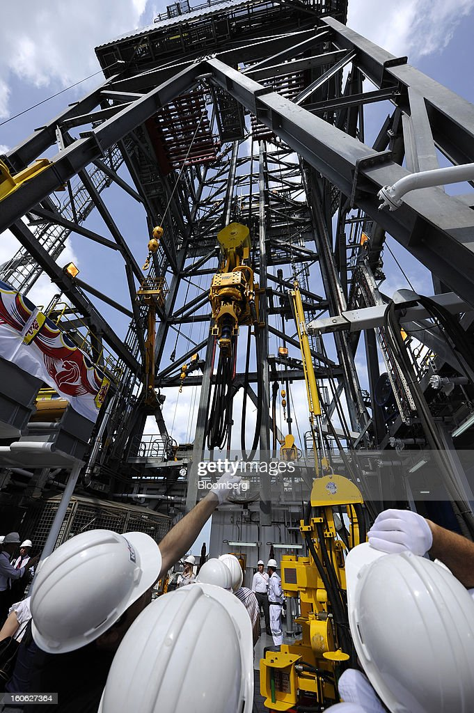 Attendees look at drilling equipment aboard the Transocean Siam Driller jackup rig, built by Keppel Corp. for Transocean Ltd., during a naming ceremony at the Keppel FELS shipyard in Singapore, on Saturday, Feb. 2, 2013. Keppel Corp.'s FELS unit received a combined $1.5 million bonus for completing the construction of two drilling rigs ahead of time, the company said in a statement. Photographer: Munshi Ahmed/Bloomberg via Getty Images