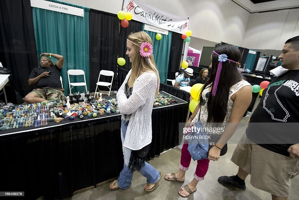 Attendees look at marijuana paraphenelia displays at the HempCon medical marijuana show, May 24, 2013 at the Los Angeles Convention Center. Thousands of marijuana enthusiasts gathered for the three-day event for exhibits of medical marijuana dispensaries, collectives, evaluation services, legal services and equipment and accessories. Under California state law, people suffering from chronic diseases have the right to grow, buy and use marijuana for medical purposes when recommended by a doctor. In 2003 the Medical Marijuana Protection Act, established an identification card system for medical marijuana patients.