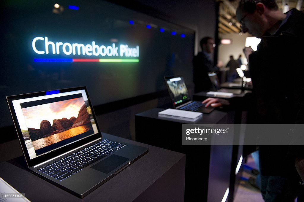 Attendees look at new Google Inc. Chromebook Pixel laptops during a launch event in San Francisco, California, U.S., on Thursday, Feb. 21, 2013. Google Inc., owner of the world's most popular search engine, debuted a touchscreen version of the Chromebook laptop, stepping up its challenge to Microsoft Corp. and Apple Inc. in hardware. Photographer: David Paul Morris/Bloomberg via Getty Images