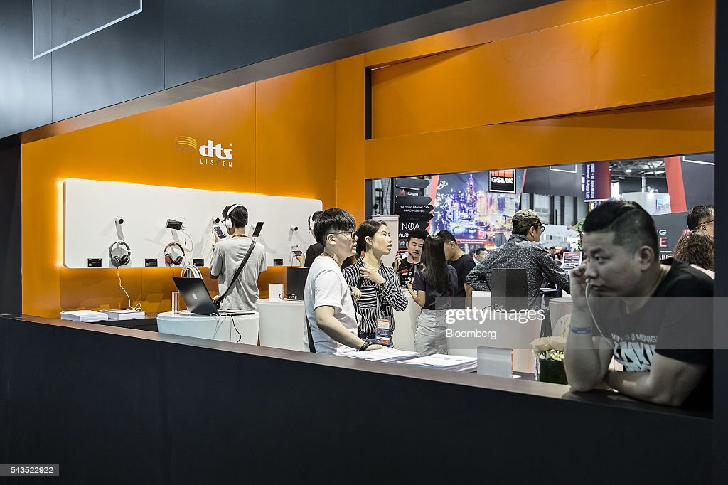 Attendees look at products displayed at the Mobile World Congress Shanghai in Shanghai, China, on Wednesday, June 29, 2016. The exhibition runs until July 1. Photographer: Qilai Shen/Bloomberg via Getty Images