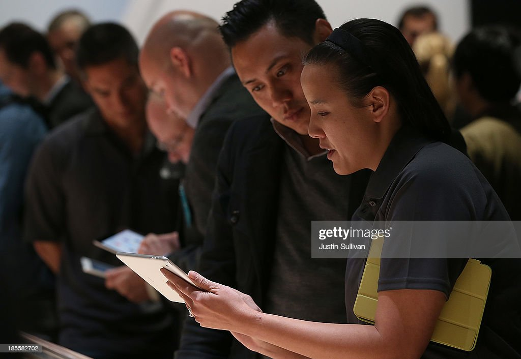 Attendees look at the new iPad Mini during an Apple announcement at the Yerba Buena Center for the Arts on October 22, 2013 in San Francisco, California. The tech giant announced its new iPad Air, a new iPad mini with Retina display, OS X Mavericks and highlighted its Mac Pro.