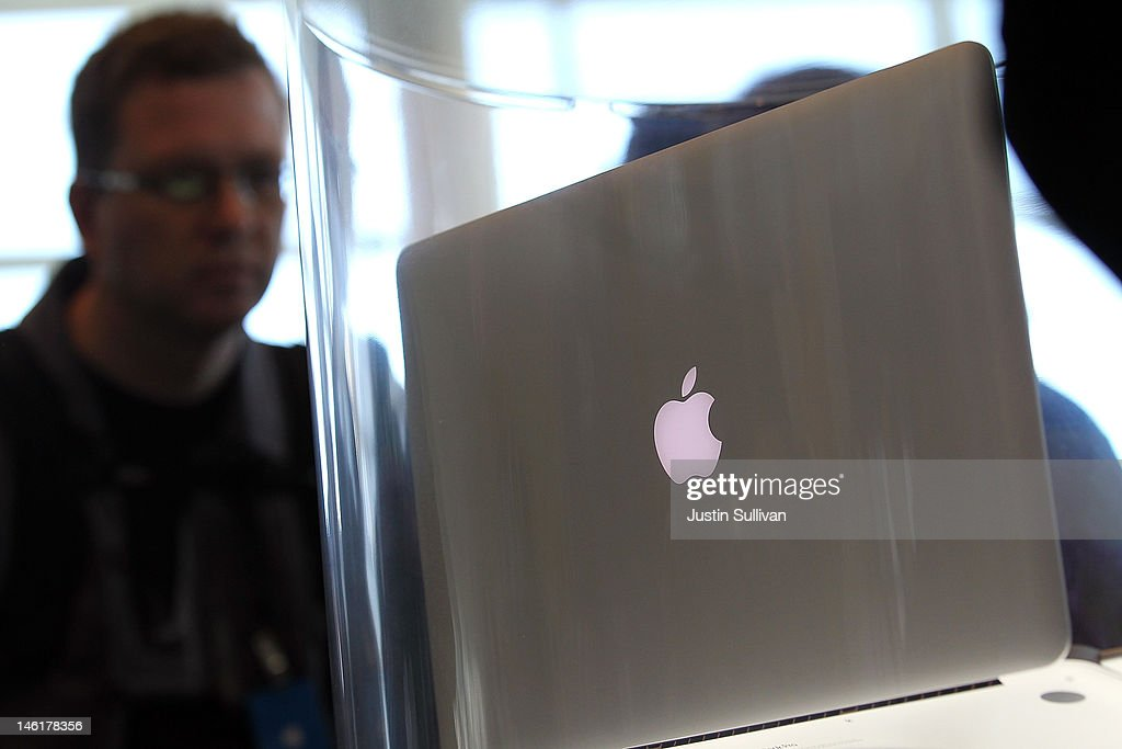 WWDC attendees look at the new MacBook Pro that is displayed following the keynote address at the Apple 2012 World Wide Developers Conference (WWDC) at Moscone West on June 11, 2012 in San Francisco, California. Apple unveiled a slew of new hardware and software updates at the company's annual developer conference which runs through June 15.