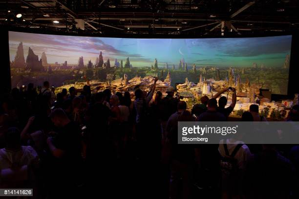 Attendees look at the Walt Disney Co 'Star Wars' lands 3D model unveiled ahead of the D23 Expo in Anaheim California US on Thursday July 13 2017 Walt...