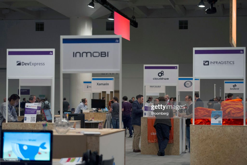 Attendees look at various booths during the Microsoft Corp. Build Developers Conference in San Francisco, California, U.S., on Wednesday, June 26, 2013. Facebook Inc. is building an application for Microsoft Corp.'s Windows 8, adding one of the most popular programs still missing from the operating system designed to help Microsoft gain tablet customers. Photographer: David Paul Morris/Bloomberg via Getty Images