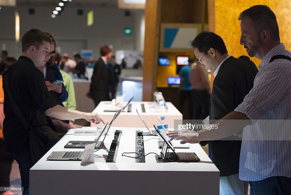 Attendees look at various devices during the Microsoft Corp. Build Developers Conference in San Francisco, California, U.S., on Wednesday, June 26, 2013. Facebook Inc. is building an application for Microsoft Corp.'s Windows 8, adding one of the most popular programs still missing from the operating system designed to help Microsoft gain tablet customers. Photographer: David Paul Morris/Bloomberg via Getty Images